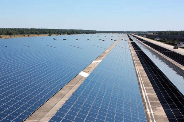 PV modules are installed across a former Soviet airfield in Brandenburg, Germany.