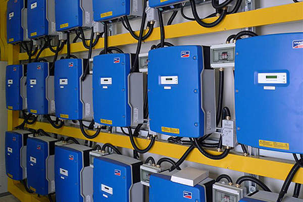 Inverters at the plant convert the DC electricity to AC.